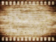 old grunge film strip with wooden background and texture