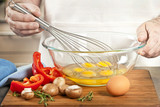 Whisking eggs in bowl