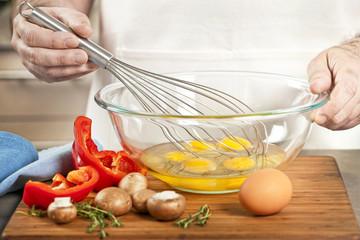 Whisking eggs in bowl
