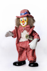 toy clown with a dollar on a white background