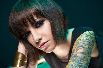 tattooed girl in studio