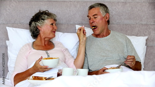 Mature couple enjoying their breakfast together