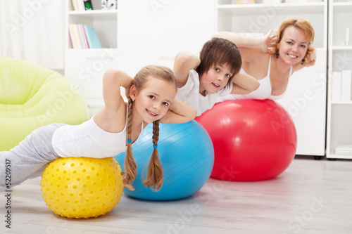 Happy healthy family exercising