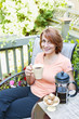 Woman relaxing in backyard