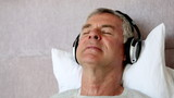 Man moving his head while listening to music