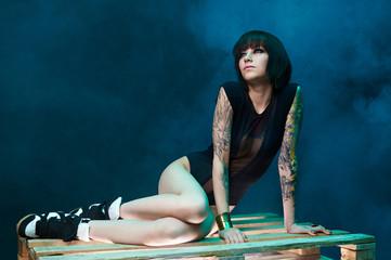 tattooed girl in studio