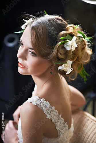 Hairstyle beauty girl woven with flowers lily