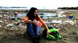 Young woman sad not being able to clean dirty beach