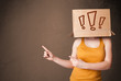 Young lady gesturing with a cardboard box on her head with excla