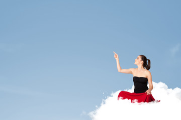 Young woman sitting on cloud with copy space