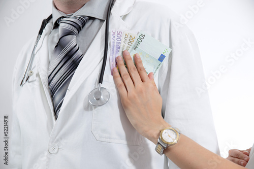 Doctor in white coat is offered money