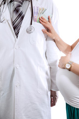 Doctor in white coat is offered money from pregnant woman