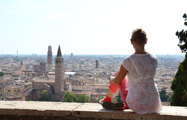 Girl looking to Verona town, Italy