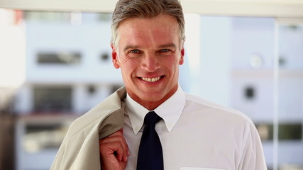 Businessman nodding in his office