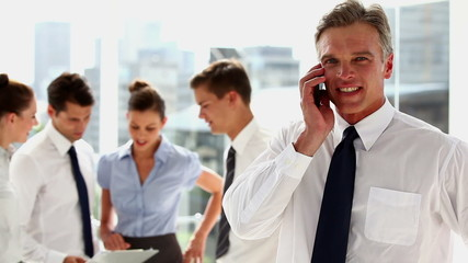 Businessman phoning in the workplace