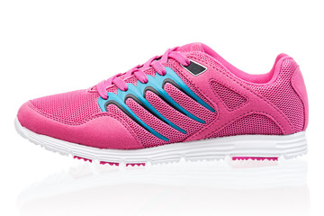 Pink female sneaker isolated over white