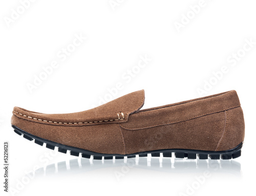 Brown male loafer over white