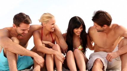 Group of friends and couple chatting together