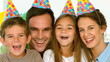 Portrait of smiling family with party hats