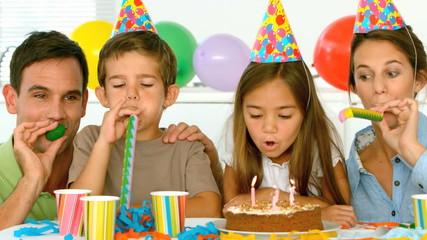 Happy family celebrating their daughter birthday
