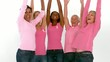 Group of cheerful women raising arms for breast cancer awareness