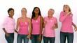 Women wearing pink ribbon against cancer dancing