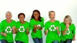 Women wearing green shirt with environment symbol dancing