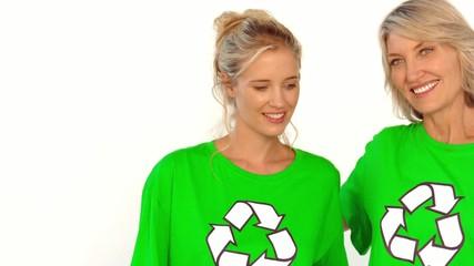 Two women wearing green shirt for the environment