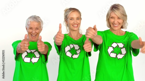 Three enviromental activists giving thumbs up