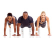 group of fit people doing pushups