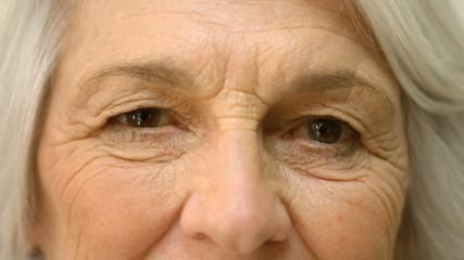 Old woman winking an eye