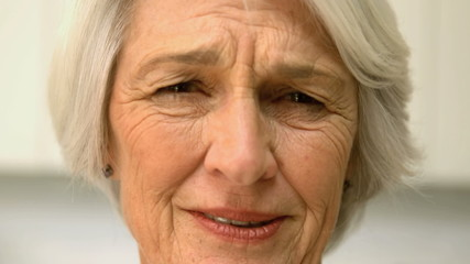Old woman seeming sad