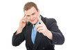 Young businessman talking on the phone pointing with finger