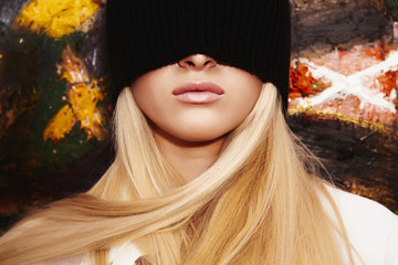 Blond woman with black blindfold