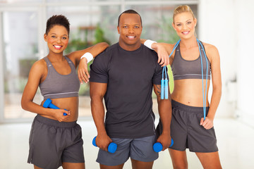 group of diversity people holding various gym equipment