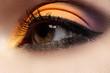 Beautiful eye with celebratory bright color eyeshadow