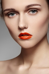 Bright visage. Chic green eye makeup and red lips make-up