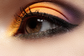 Beautiful eye with celebratory bright color eyeshadow