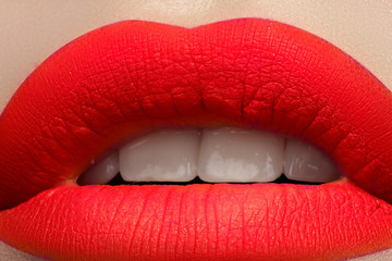 Beautiful full lips with bright fashion mat orange makeup