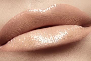 Woman's lips with fashion natural beige lipstick makeup