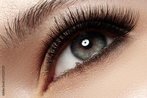 Macro of beautiful eye with extremely long eyelashes - 52220729
