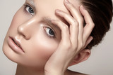 Fashion winter make-up with shiny skin, sparkles brows poster