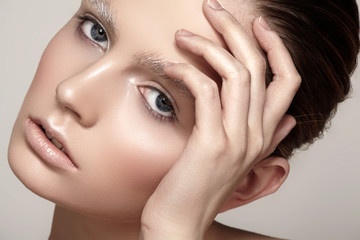 Fashion winter make-up with shiny skin, sparkles brows