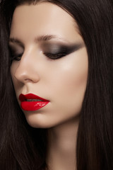 model with glamour red lips make-up, eye arrow makeup