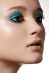 woman face with fashion eyes makeup and pure skin