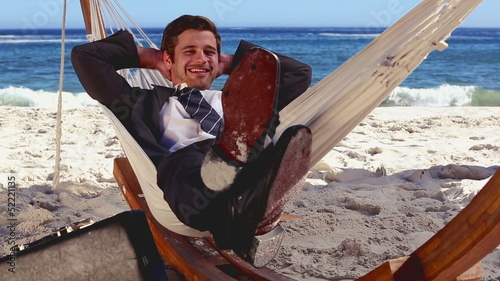 Buisnessman relaxing in hammock