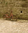 old child bicycle with cobble and wall