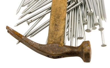 curvy vintage rusty hammer nails pile isolated