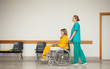 Nurse pushing the wheelchair of a patient