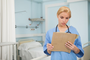 Nurse looking at a folder